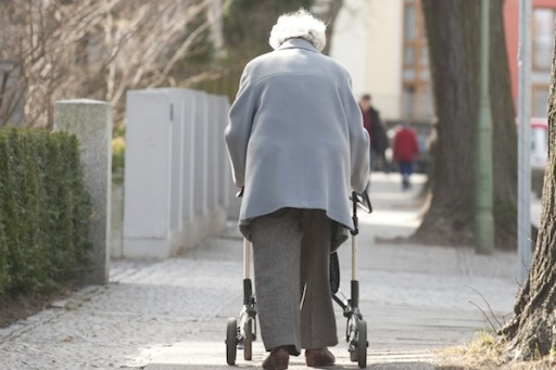 An elderly woman takes a walk near the Agaplesion Bethanien Sophienhaus home for the elderly in Berlin March 23, 2011. The German cabinet has proposed a law that would enable employees to reduce working hours to care for older relatives and get financial compensation from the state. AFP PHOTO / JOHN MACDOUGALL (Photo credit should read JOHN MACDOUGALL/AFP/Getty Images)